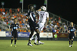 29 May 2012: Carolina's Gale Agbossoumonde (left) and Los Angeles' Pat Noonan (11) challenge for a header. The Carolina RailHawks (NASL) defeated the Los Angeles Galaxy (MLS) 2-1 at WakeMed Soccer Stadium in Cary, NC in a 2012 Lamar Hunt U.S. Open Cup third round game.