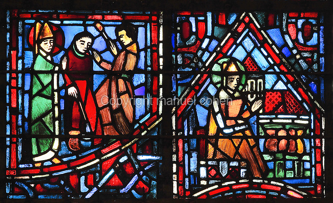 Fulbert the art lover (left) advising 2 painters holding their brushes and Fulbert as treasurer of the Church of St Hilary of Poitiers (right), from the Life of Fulbert stained glass window, in the south transept of Chartres Cathedral, Eure-et-Loir, France. This window replaces the original 13th century window depicting the Life of St Blaise, which was destroyed in 1791. It was created in 1954 by Francois Lorin as a gift of the Institute of American Architects, on a theme chosen by the Canon Yves Delaporte. It depicts the life of Fulbert, bishop of Chartres in the 11th century. Chartres cathedral was built 1194-1250 and is a fine example of Gothic architecture. Most of its windows date from 1205-40 although a few earlier 12th century examples are also intact. It was declared a UNESCO World Heritage Site in 1979. Picture by Manuel Cohen