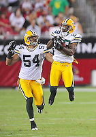 Aug. 28, 2009; Glendale, AZ, USA; Green Bay Packers safety (29) Anthony Smith intercepts a pass as linebacker (54) Brandon Chillar looks on against the Arizona Cardinals during a preseason game at University of Phoenix Stadium. Mandatory Credit: Mark J. Rebilas-