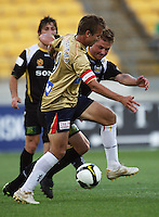 Newcastle captain Joel Griffiths takes on Ben Sigmund during the A-League match between Wellington Phoenix and Newcastle Jets at Westpac Stadium, Wellington, New Zealand on Sunday, 4 January 2009. Photo: Dave Lintott / lintottphoto.co.nz