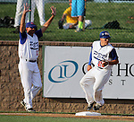SIOUX FALLS, SD - AUGUST 12:  Preston Davis #23 from Dell Rapids PBR is held up at third by coach Clarence Fjellanger #14 after taking the base following a stolen base against the Salem Cubs, Monday night in the fifth inning during the State Amateur Baseball Tournament at the Sioux Falls Stadium.  (Photo by Dave Eggen/Inertia)