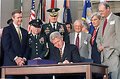 Washington, DC - October 5, 1999 -- UNited States President Bill Clinton signs the $289 Billion Defense Appropriation Bill at a ceremony at the Pentagon on 5 October, 1999.  Behind The President (L-R) US Secretary of Defense William Cohen, Sergeant Major of the Army Robert Hall, Chairman of the Joint Chiefs of Staff Henry Shelton, US Representative Floyd Spence (R-2-South Carolina), US Senator John Warner (R-Virginia), and US Representative Ike Skelton (D-11-Missouri)<br /> Credit: Ron Sachs / CNP