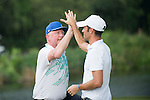 Boris Becker (left) and Luis Garcia congratulate themselves  during the World Celebrity Pro-Am 2016 Mission Hills China Golf Tournament on 23 October 2016, in Haikou, Hainan province, China. Photo by Marcio Machado / Power Sport Images
