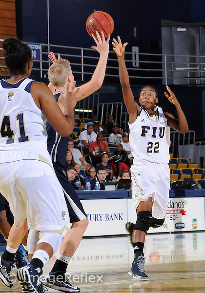 Florida International University guard Jerica Coley (22) plays against Nova Southeastern University. FIU won the game 75-69 on October 27, 2013 at Miami, Florida.