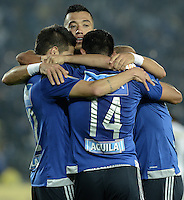 BOGOTA - COLOMBIA -25 -03-2015: Jugadores de Millonarios celebran un gol anotado por David Silva a Deportivo Pasto durante partido aplazado por la fecha 1 de la Liga Águila I 2015 jugado en el estadio Nemesio Camacho El Campín de la ciudad de Bogotá./ Millonarios players celebrate a goal scored by David Silva to Deportivo Pasto during the postponed match for the first date of the Aguila League I 2015 played at Nemesio Camacho El Campin stadium in Bogotá city. Photo: VizzorImage / Gabriel Aponte / Staff.