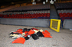 Broken seats piled up on the trackside after the game
