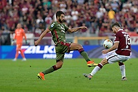 27th October 2019; Olympic Grande Torino Stadium, Turin, Piedmont, Italy; Serie A Football, Torino versus Cagliari; Cristian Ansaldi of Torino FC challenges Lucas Castro of Cagliari - Editorial Use