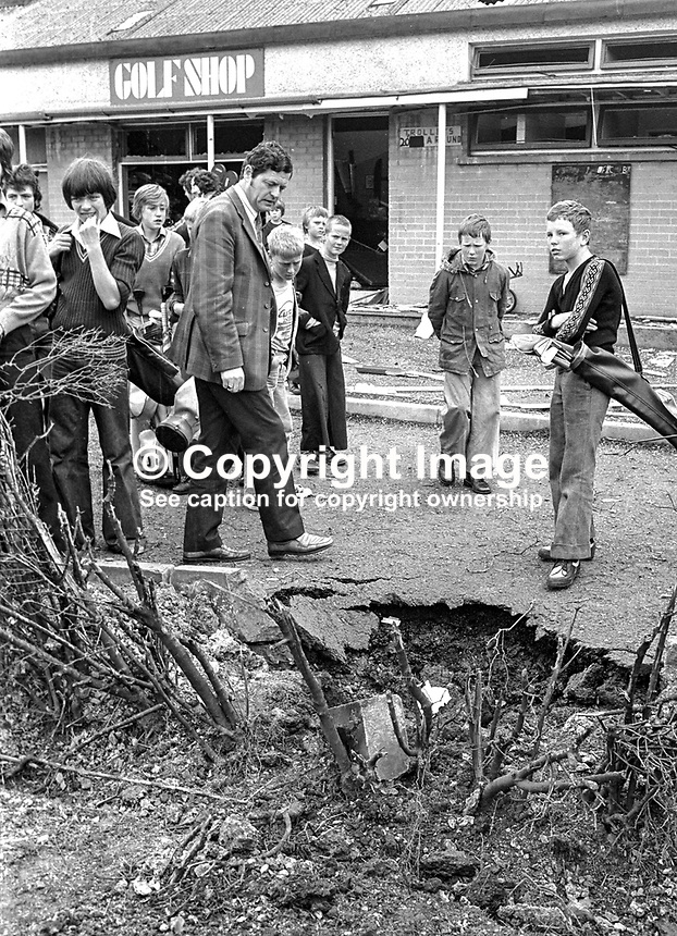 Club members, predominently juniors, view the crater left by a Provisional IRA bomb at Balmoral Golf Club, Belfast, N Ireland, 5th August 1976. The bomb, planted by two men, was carried outside by Jean Daly, wife of the club's former professional, Fred Daly, winner of The Open in 1947. It exploded causing only superficial damage. 197608050339a..Copyright Image from Victor Patterson, 54 Dorchester Park, Belfast, UK, BT9 6RJ..Tel: +44 28 9066 1296.Mob: +44 7802 353836.Voicemail +44 20 8816 7153.Skype: victorpattersonbelfast.Email: victorpatterson@me.com.Email: victorpatterson@ireland.com (back-up)..IMPORTANT: If you wish to use this image or any other of my images please go to www.victorpatterson.com and click on the Terms & Conditions. Then contact me by email or phone with the reference number(s) of the image(s) concerned.