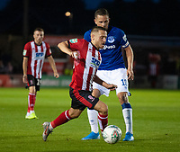 Lincoln City's Jack Payne vies for possession with Everton's Gylfi Sigur_sson<br /> <br /> Photographer Andrew Vaughan/CameraSport<br /> <br /> The Carabao Cup Second Round - Lincoln City v Everton - Wednesday 28th August 2019 - Sincil Bank - Lincoln<br />  <br /> World Copyright © 2019 CameraSport. All rights reserved. 43 Linden Ave. Countesthorpe. Leicester. England. LE8 5PG - Tel: +44 (0) 116 277 4147 - admin@camerasport.com - www.camerasport.com