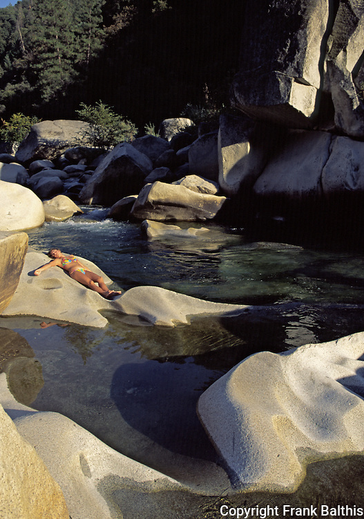 Woman sunbathing and swimming at South Yuba River