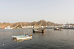 Sunsets on the boats in the Sultan Qaboos harbor in Muscat, Oman.