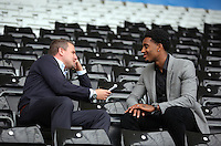Leroy Fer (R) with reporter Gareth Vincent (L), who has signed a three year deal for an undisclosed amount with Swansea City FC, Wales, UK