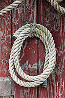 Nautical rope hangs on a weathered shack, New England, USA