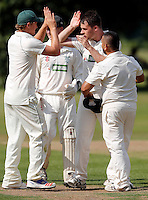 Matthew Rosson (2nd R) of North London is congratulated  after he bowled a Brentham player during the Middlesex County Cricket League Division Three game between North London and Brentham at Park Road, London, on Sat July 23, 2016