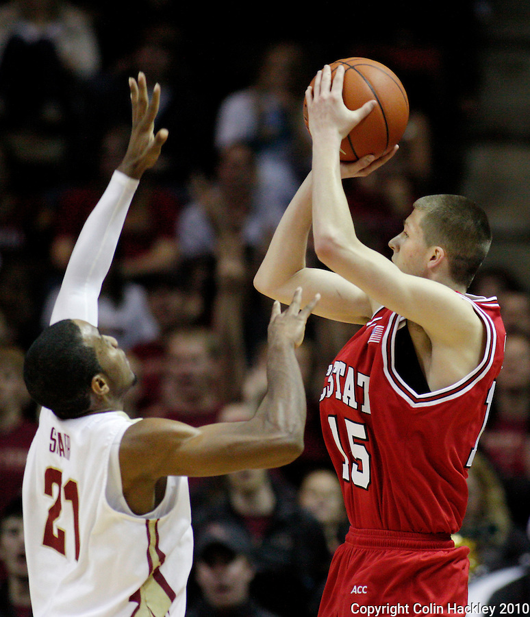 TALLAHASSEE, FL 10-FSU-NCSTBB10 CH27-Florida State's Michael Snaer, left, tries to defend N.C. State high-scorer Scott Wood during second half action Tuesday at the Donald L. Tucker Center in Tallahassee. Wood had 31 points helping the Wolfpack beat the Seminoles 88-81...COLIN HACKLEY PHOTO