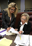 Nevada Assembly Republicans Michele Fiore, left, and Victoria Dooling work on the Assembly floor at the Legislative Building in Carson City, Nev., on Monday, March 16, 2015. <br /> Photo by Cathleen Allison