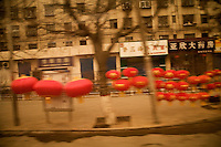 Red lanterns hang along the streetside in Lanzhou, Gansu, China.