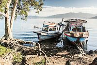 Old rusty fishing boats in a village at Lake Toba (Danau Toba), North Sumatra, Indonesia