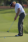 Miguel Angel Jimenez eyes up his putt on the 18th during the second round of the Dubai World Championship on the Earth Course at the Jumeirah Golf Estate, Dubai..Picture Fran Caffrey/www.golffile.ie.