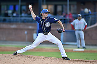 Asheville Tourists pitcher Logan Norris #8 delivers a pitch during a game against the  Greenville Drive at McCormick Field on May 17, 2014 in Asheville, North Carolina. The Tourists defeated the Drive 14-6. (Tony Farlow/Four Seam Images)