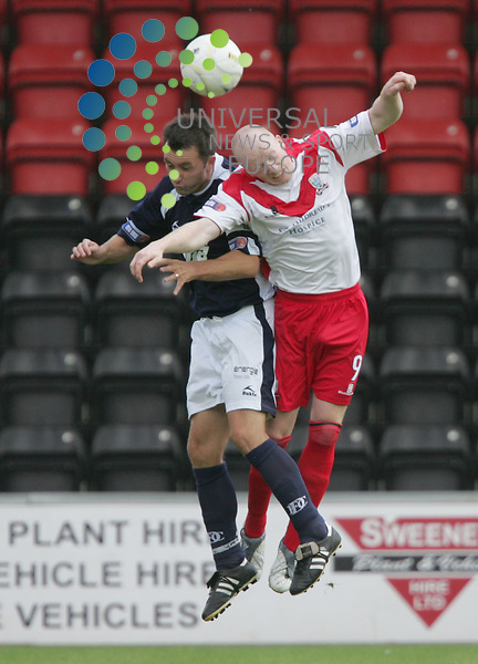 Scott Gemmill takes on Eric Paton during the  SFL division one Airdrie United v Dundee FC at Excelsior Stadium, Airdrie..Picture: Universal News And Sport (Scotland) 29 August 2009..