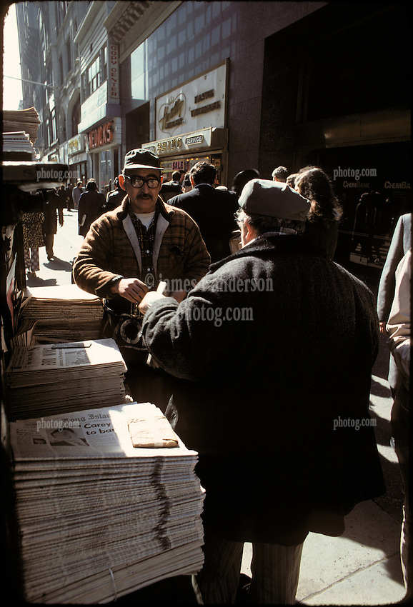 "Newstand selling papers with ""Ford Wins"" the primary, Brooklyn, New York City, February 25, 1976"