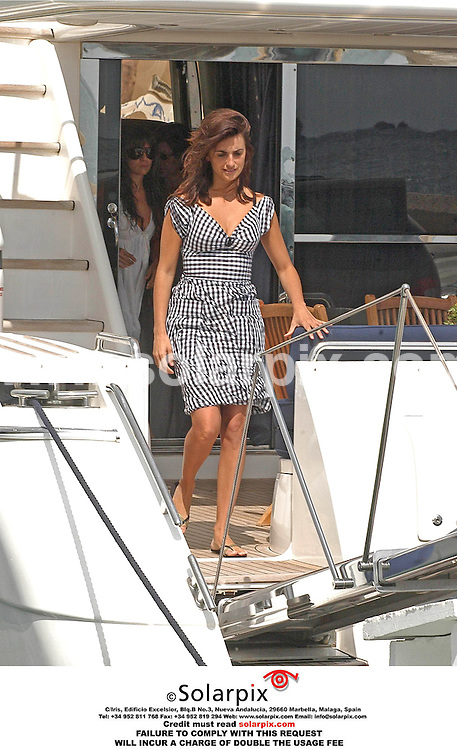 ALL-ROUND PICTURES FROM SOLARPIX.COM .Penelope Cruz set sail for a day on on board a luxury yacht in Ibiza this weekend. The Spanish movie star sported a black wrap-around bikini while she chatted on her mobile phone on deck..REF:  2712 SPA