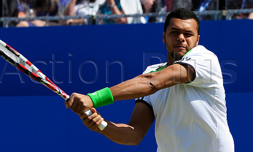 11.06.2011 The AEGON Championships from Queens Club in London. Jo-Wilfried Tsonga of France returns a shot in his match against James Ward of Great Britain on day six of the Aegon Championships at the Queen's Club.