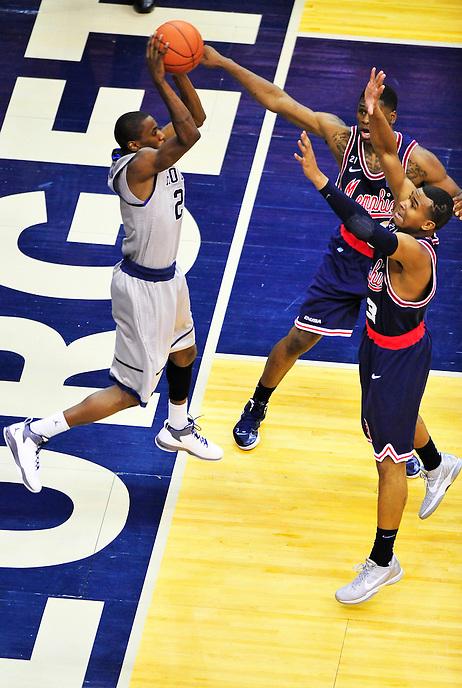 Jason Clark of the Hoyas tries to keep the ball inbound. Georgetown defeated Memphis 70-59 at the Verizon Center in Washington, D.C. on Thursday, December 22, 2011. Alan P. Santos/DC Sports Box