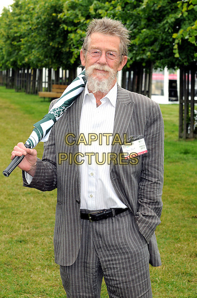 John Hurt<br /> RHS Hampton Court Palace Flower Show at Hampton Court Palace, London, England.<br /> July 2nd 2012<br /> half length white shirt grey gray pinstripes suit glasses umbrella goatee beard facial hair <br /> CAP/BK/PP<br /> &copy;Bob Kent/PP/Capital Pictures