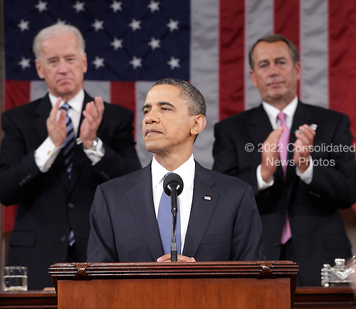 United States President Barack Obama is applauded by Vice President Joe Biden and House Speaker John Boerhner on Capitol Hill in Washington, Tuesday, Jan. 25, 2011, while delivering his State of the Union address  .Credit: Pablo Martinez Monsivais / Pool via CNP