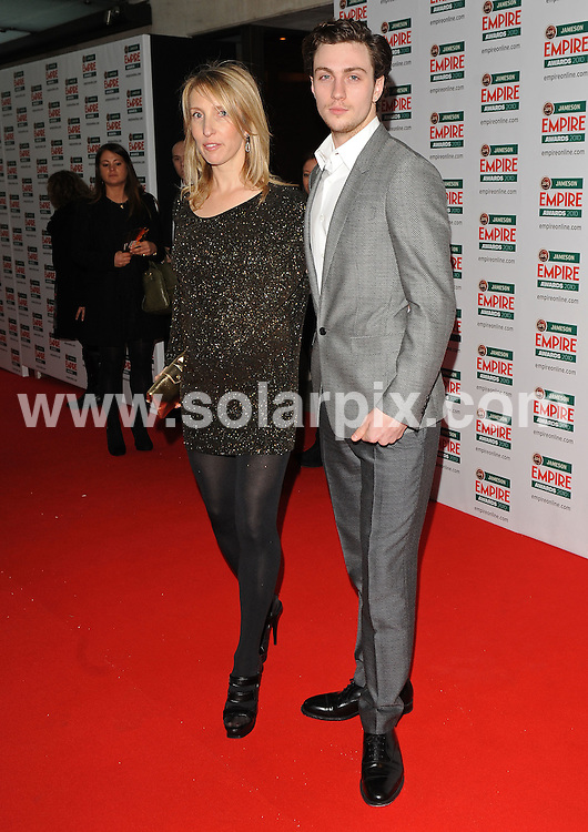 **ALL ROUND PICTURES FROM SOLARPIX.COM**.**WORLDWIDE SYNDICATION RIGHTS**.Red carpet arrivals at the Jameson Empire Awards 2010. Held at Grosvenor House, Mayfair, London, UK. 28 March 2010..This pic: Sam Taylor-Wood and Aaron Johnson..JOB REF: 10995 SSD    DATE: 28_03_2010.**MUST CREDIT SOLARPIX.COM OR DOUBLE FEE WILL BE CHARGED**.**MUST NOTIFY SOLARPIX OF ONLINE USAGE**.**CALL US ON: +34 952 811 768 or LOW RATE FROM UK 0844 617 7637**