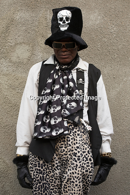 "KINSHASA, DEMOCRATIC REPUBLIC OF CONGO - FEBRUARY 13: A Sapeur from the group belonging to Papa Griffe poses for a portrait February 13, 2016 in Kinshasa, DRC. The word Sapeur comes from SAPE, a French acronym for Société des Ambianceurs et Persons Élégants. or Society of Revellers and Elegant People. and it also means, .to dress with elegance and style"". Most of the young Sapeurs are unemployed, poor and live in harsh conditions in Kinshasa, a city of about 10 million people. For many of them being a Sapeur means they can escape their daily struggles and dress like fashionable Europeans. Many hustle to build up their expensive collections. Most Sapeurs could never afford to visit Paris, and usually relatives send or bring clothes back to Kinshasa. (Photo by Per-Anders Pettersson)"