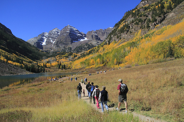 Students and teacher hiking along Maroon Lake, with South and North Maroon Peaks behind, near the town of Aspen, Colorado.