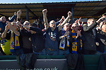 Visiting supporters celebrating after Warrington Town defeated King's Lynn Town in the Northern Premier League premier division super play-off final tie at Cantilever Park, Warrington. The one-off match was between the winners of play-off matches in the Northern Premier League and the Southern League Premier Division Central to determine who would be promoted to the National League North. The visitors from Norfolk won 3-2 after extra-time, watched by a near-capacity crowd of 2,200.