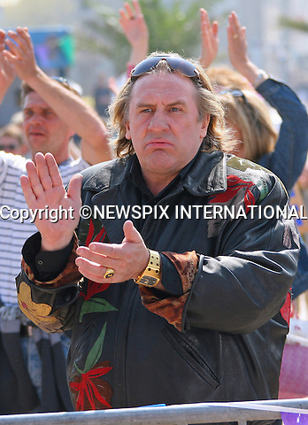 "GERARD DEPARDIEU PROTESTS NEW FRENCH TAX AND MOVES TO BELGIUM.Actor Gérard Depardieu,64, star of the ""Green Card"" has purchased a substantial property valued at ?3 million that belonged to the Mulliez family..The property constructed by the architect Rock Small, who is well known in the region of Turn, contains an indoor swimming pool and Jacuzzi..The property is situated in Nechin, 300 metres from the French-Belgian border..France has introduced a new massive tax hike on the rich of 75 per cent on all earnings over ?1 million..The Mulliez family own the Auchan chain of stores in Europe_28/12/2012.Mandatory Photo Credit: ©Guizard/News Pictures/NEWSPIX INTERNATIONAL.Picture Shows : Gerard Depardieu  on set of ""Tournage de Disco""..**ALL FEES PAYABLE TO: ""NEWSPIX INTERNATIONAL""**..PHOTO CREDIT MANDATORY!!: NEWSPIX INTERNATIONAL..IMMEDIATE CONFIRMATION OF USAGE REQUIRED:.Newspix International, 31 Chinnery Hill, Bishop's Stortford, ENGLAND CM23 3PS.Tel:+441279 324672  ; Fax: +441279656877.Mobile:  0777568 1153.e-mail: info@newspixinternational.co.uk"