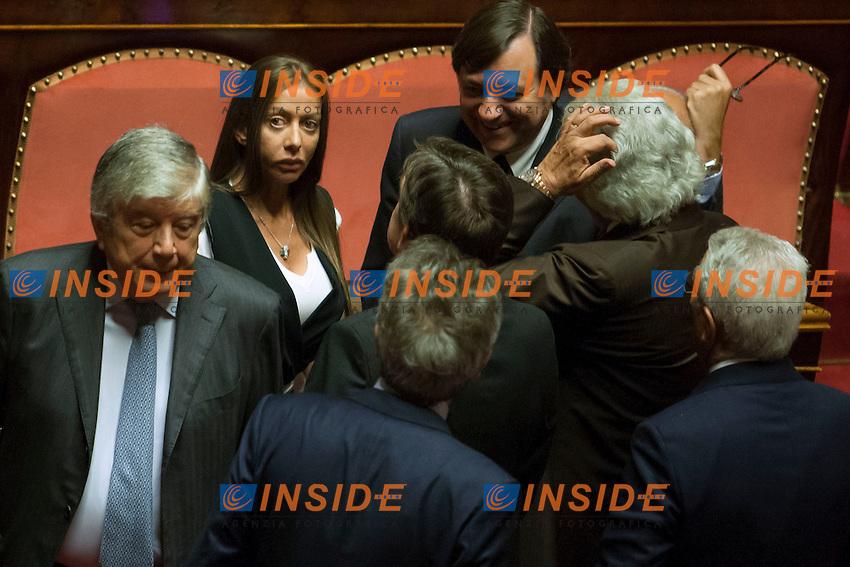 Maria Rosaria Rossi circondata dai senatori di Forza Italia<br /> Roma 01-08-2014  Senato. Discussione sul DdL Riforme costituzionali che prevede anche la riforma del Senato. <br /> Photo Samantha Zucchi Insidefoto