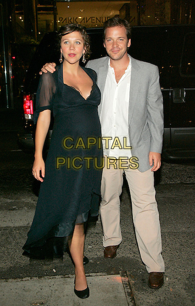 "MAGGIE GYLLENHAAL & PETER SARSGAARD.Arrives at the afterparty for the NY Premiere of ""World Trade Center"" at the Lever House Restaurant, New York, NY, USA..August 3rd, 2006.Ref: ADM/JL.full length blue black dress sheer pregnant  couple grey gray suit jacket.www.capitalpictures.com.sales@capitalpictures.com.©Jackson Lee/AdMedia/Capital Pictures."