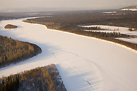 Aerial of sled dog team running on Kuskokwim River from Nikolai to McGrath 2006 Iditarod Western Alaska