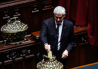 Il senatore Pierferdinando Casini depone la scheda nell'urna durante la seduta comune di deputati e senatori per l'elezione del nuovo Presidente della Repubblica, alla Camera dei Deputati, Roma, 30 gennaio 2015.<br /> Italian senator Pierferdinando Casini casts his ballot during a joint plenary session of senators and deputies to vote for the election of the new President, at the Lower Chamber, Rome, 30 January 2015.<br /> UPDATE IMAGES PRESS/Riccardo De Luca