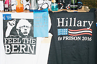 "A vendor sold Bernie Sanders-themed t-shirts alongside a ""Hillary For Prison"" t-shirt outside the secure area surrounding the Democratic National Convention at the Wells Fargo Center in Philadelphia, Pennsylvania, on Wed., July 27, 2016. ""Hillary For Prison"" has been a common slogan at Republican campaign events during the election cycle."