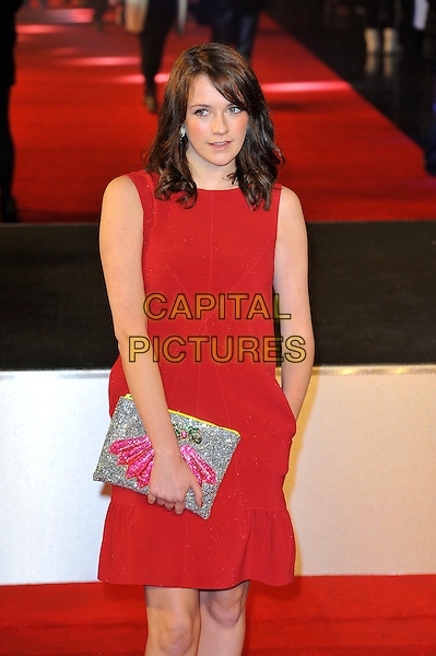 "Charlotte Ritchie.The ""G.I. Joe 2: Retaliation"" UK film premiere, Empire cinema, Leicester Square, London, England..March 18th, 2013.half length dress red sleeveless silver clutch bag hand in pocket .CAP/MAR.© Martin Harris/Capital Pictures."