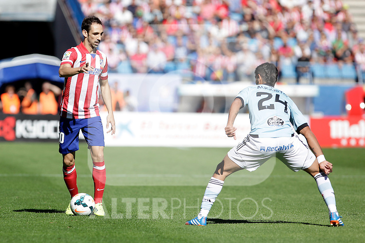 Atletico de Madrid´s Juanfran (L) and Celta de Vigo´s Augusto during La Liga 2013/14 match. October 06, 2013. (ALTERPHOTOS/Victor Blanco)