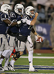 Nevada's Cody Fajardo (17) celebrates with teammates after running in a touchdown against San Jose State during the second half of an NCAA college football game in Reno, Nev., on Saturday, Nov. 16, 2013.<br /> (AP Photo/ Cathleen Allison).
