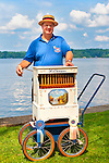 Aug. 25, 2012 - Middlebury, Connecticut, U.S. -- DAN WILKE, Organ Grinder from Buffalo NY, who is a member of Carousel Organ Association of America, plays music along Lake Quassapaug, during CAOO's Organ Rally at Quassy Amusement Park.