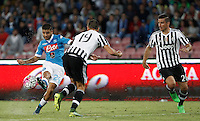 Calcio, Serie A: Napoli vs Juventus. Napoli, stadio San Paolo, 26 settembre 2015. <br /> Napoli&rsquo;s Lorenzo Insigne, left, is challenged by Juventus&rsquo; Leonardo Bonucci, center, and Simone Padoin during the Italian Serie A football match between Napoli and Juventus at Naple's San Paolo stadium, 26 September 2015.<br /> UPDATE IMAGES PRESS/Isabella Bonotto