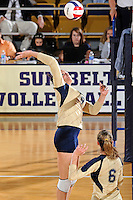 17 November 2011:  FIU middle blocker Silvia Carli (9) hits a kill shot in the first set as the FIU Golden Panthers defeated the Denver University Pioneers, 3-1 (25-21, 23-25, 25-21, 25-18), in the first round of the Sun Belt Conference Tournament at U.S Century Bank Arena in Miami, Florida.