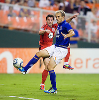 Chris Pontius (13) of D.C. United has his shot blocked by Phil Neville (18) of Everton during their friendly match held at RFK Stadium in Washington, DC.  D.C. United lost to Everton, 3-1.