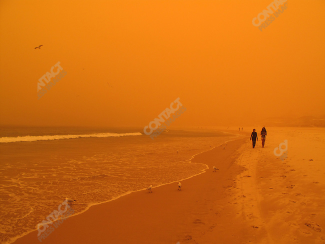 The worst dust storm in seventy years started in the drought stricken outback and covered much of Eastern Australia leaving Bondi Beach in an orange haze. Sydney, Australia, September 23, 2009.