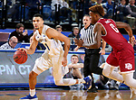 BROOKINGS, SD - JANUARY 13: Skyler Flatten #1 from South Dakota State University drives past Ade Murkey #0 from Denver during their game Saturday afternoon at Frost Arena in Brookings, SD.  (Photo by Dave Eggen/Inertia)